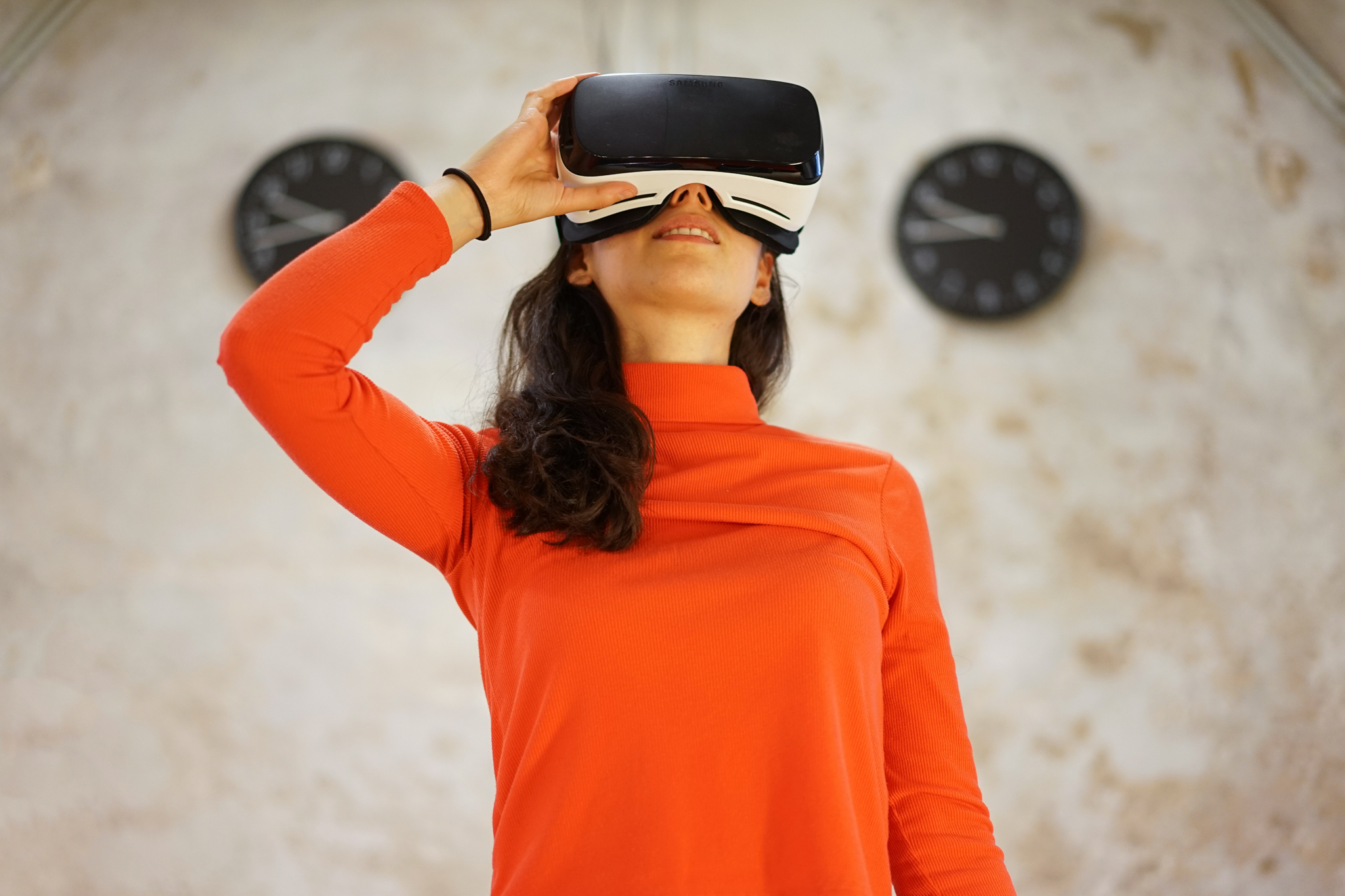 AllWomen - woman using virtual reality glasses vr